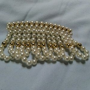 Pearl and gold hair accessory